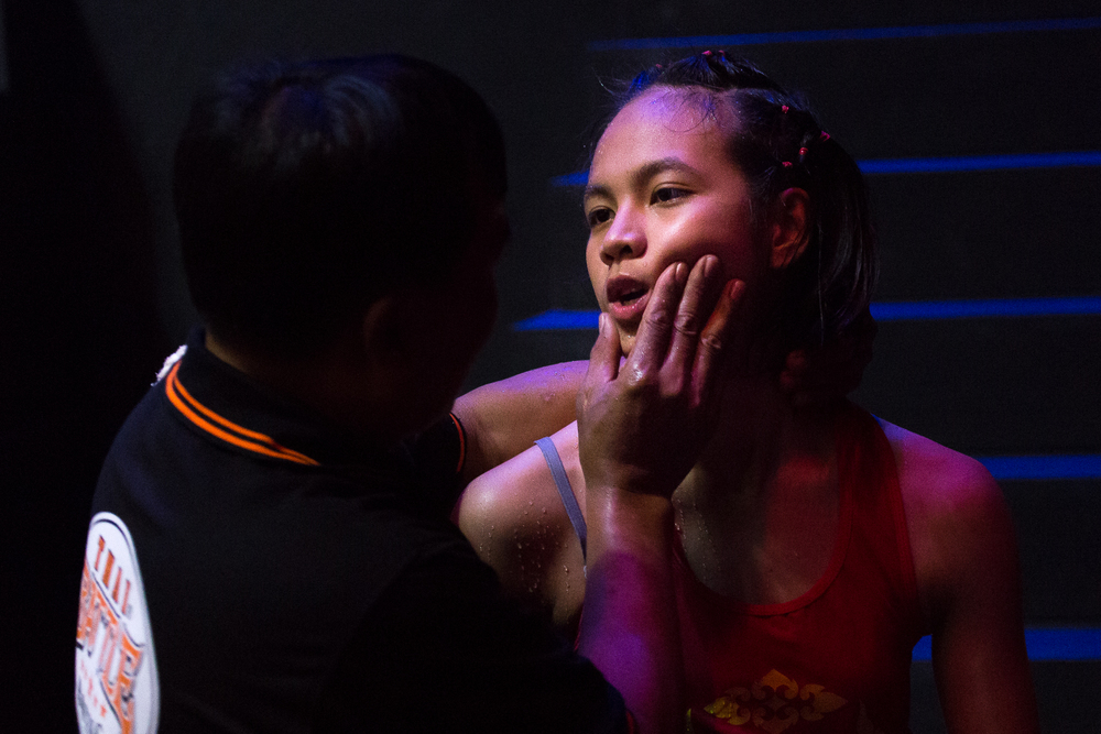 After Sai   exits the ring hanging her head in defeat after losing the match, Phom holds up her chin and tells her to be proud of her performance. It was a hard-fought matched that lasted three rounds, and   Sai   narrowly missed victory.