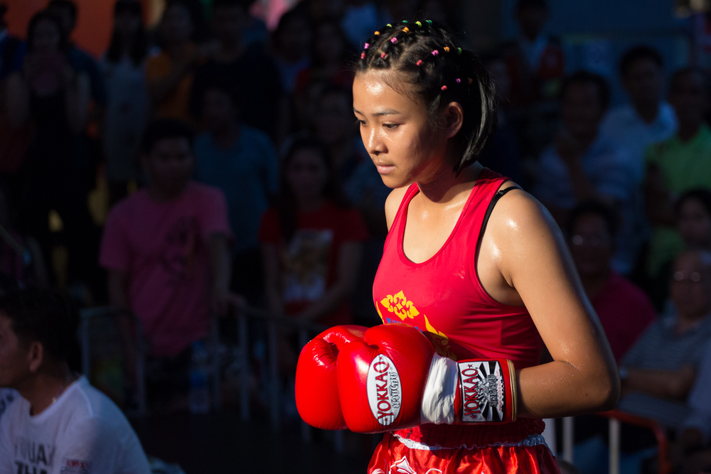 First is another fighter who trains with Phom. She enters the ring at MBK in downtown Bangkok to fight on March 30th, 2016. First began fighting because of her family's obsession with Muay Thai.