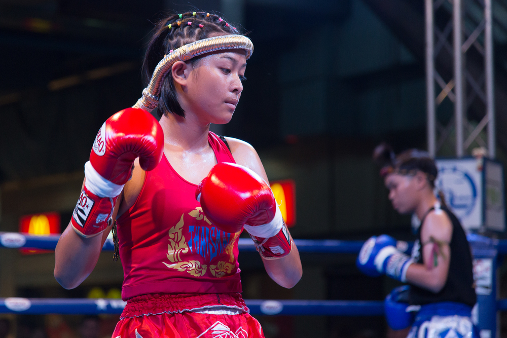 First   dons a decorative headband and dances around the ring in preparation for the fight. It is tradition for fighters to perform the Wai Kru Ram Muay, a traditional dance, before beginning a match.