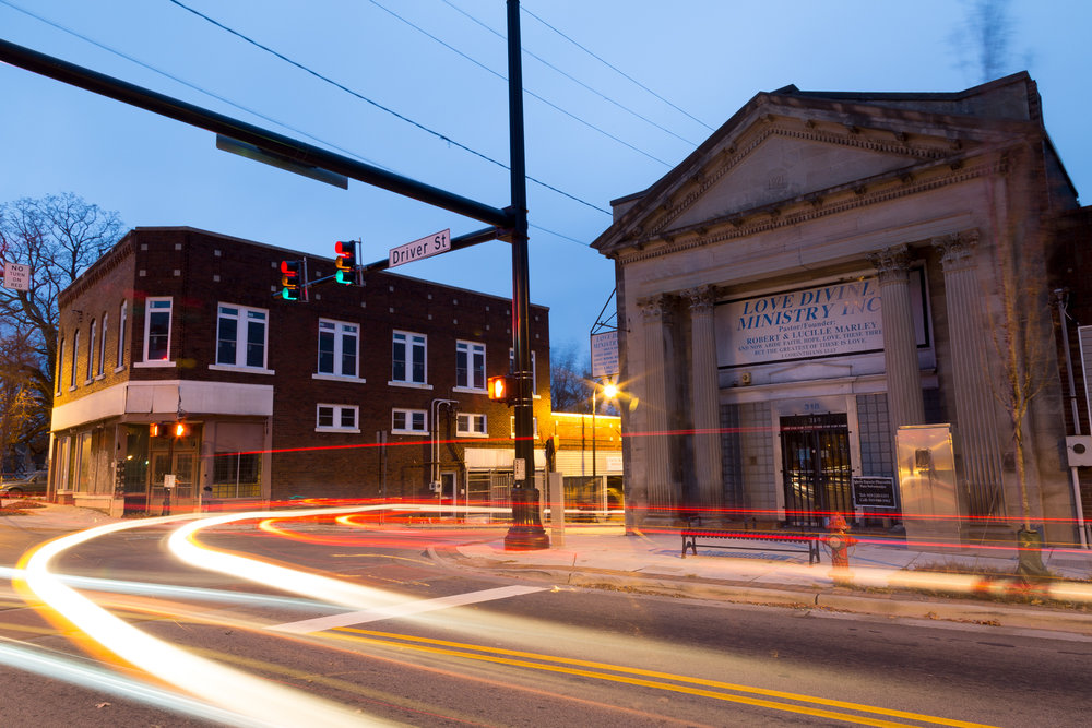 Cars pass through the intersection of Driver Street and Angier Avenue in the early hours of the morning. This part of town has been developed over the past few years and is now a center of activity within the community.