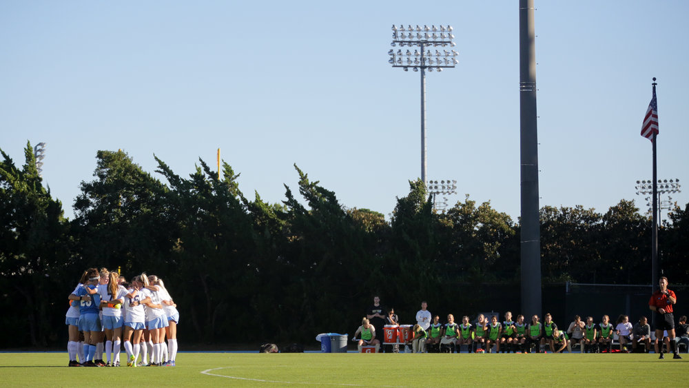 The UNC Women's Soccer Team huddles on Fetzer Field before a game against Wake Forest University on Oct. 9th, 2016. If they win, this would be Coach Dorrance's 800th career win. Dorrance has the most wins of any coach in college soccer history, and he has won 22 national championships since 1981.