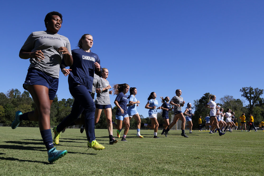 The team runs to warm up for practice at Finley Fields, which is where they regularly practice.