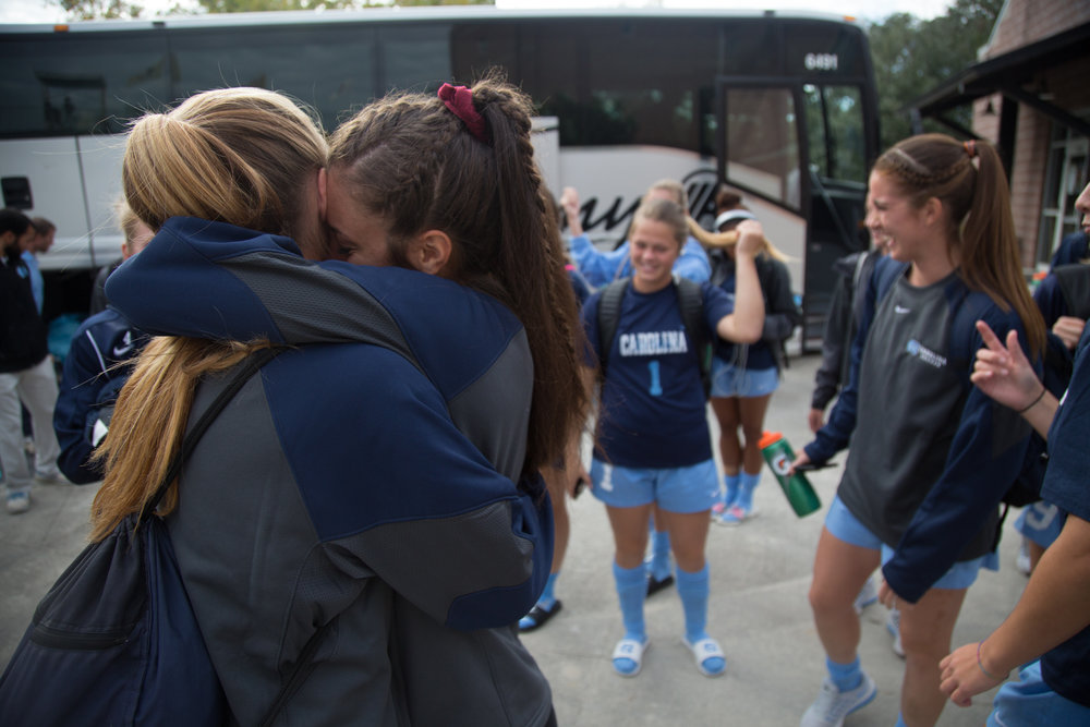 Abby Einsky hugs Annie Kingman after getting off the bus before the first game of the 2016 A.C.C. Women's Soccer Championship in Charleston, S.C.
