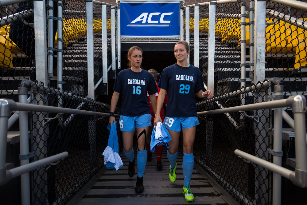 Julia Ashley and Dorian Bailey exit the locker rooms at  M.U.S.C. Health Stadium in Charleston, S.C., to warm up for the A.C.C. Championship.