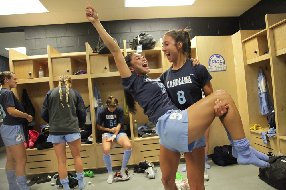 Jenny Chiu and Abby Elinsky celebrate in the locker room at the A.C.C. Championship in Charleston, S.C.