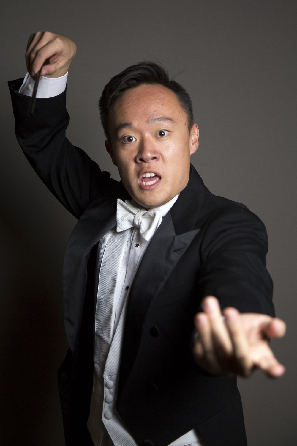 UNC-Chapel Hill senior Eric Lee conducts an invisible orchestra in a posed portrait on Halloween night in Chapel Hill Tuesday, Oct. 31st, 2017.