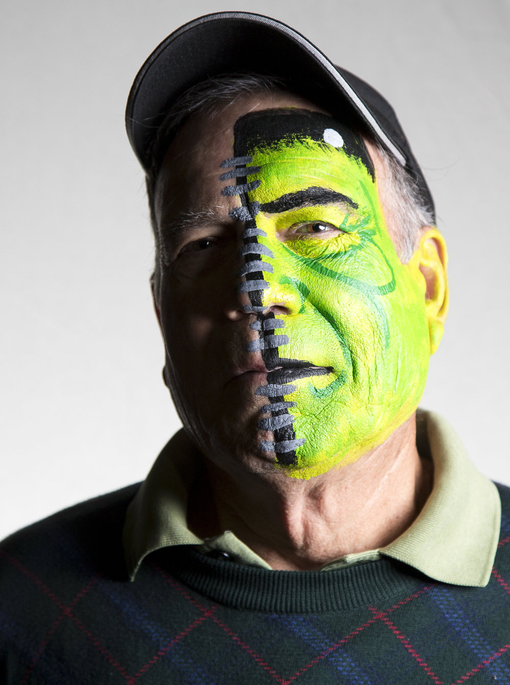 Chapel Hill resident Ed Bowen poses for a portrait with half of his face painted on Halloween in Chapel Hill Tuesday, Oct. 31, 2017. His granddaughter is the artist responsible for the face paint.
