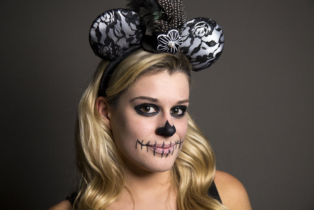 UNC-Chapel Hill student Kirby Elizabeth poses for a portrait dressed as a zombie mouse on Halloween night in Chapel Hill Tuesday, Oct. 31, 2017.