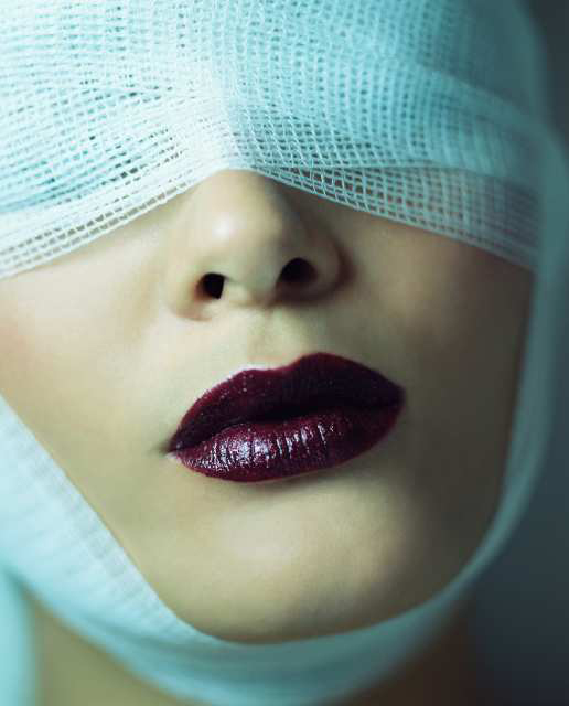 Woman wearing bandage and lipstick