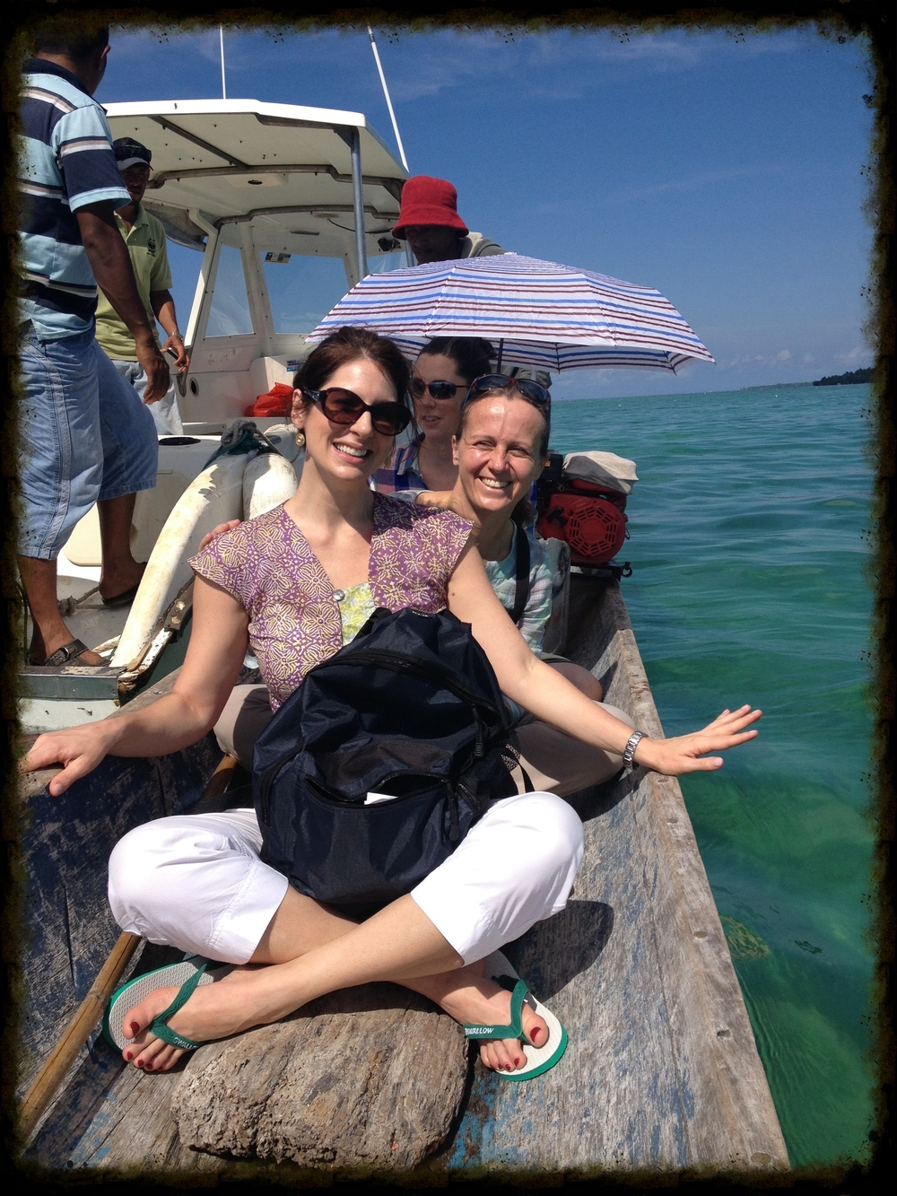 Rebekah and NGO workers board a dugout canoe in the farthest Indonesian archipelago to plant mangroves and restore ecology.
