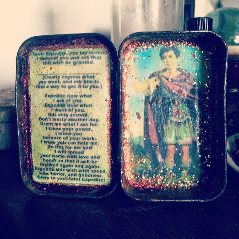Inside of tiny St. Expedite altar in Altoids tin repurposed by Papa Toad Bone