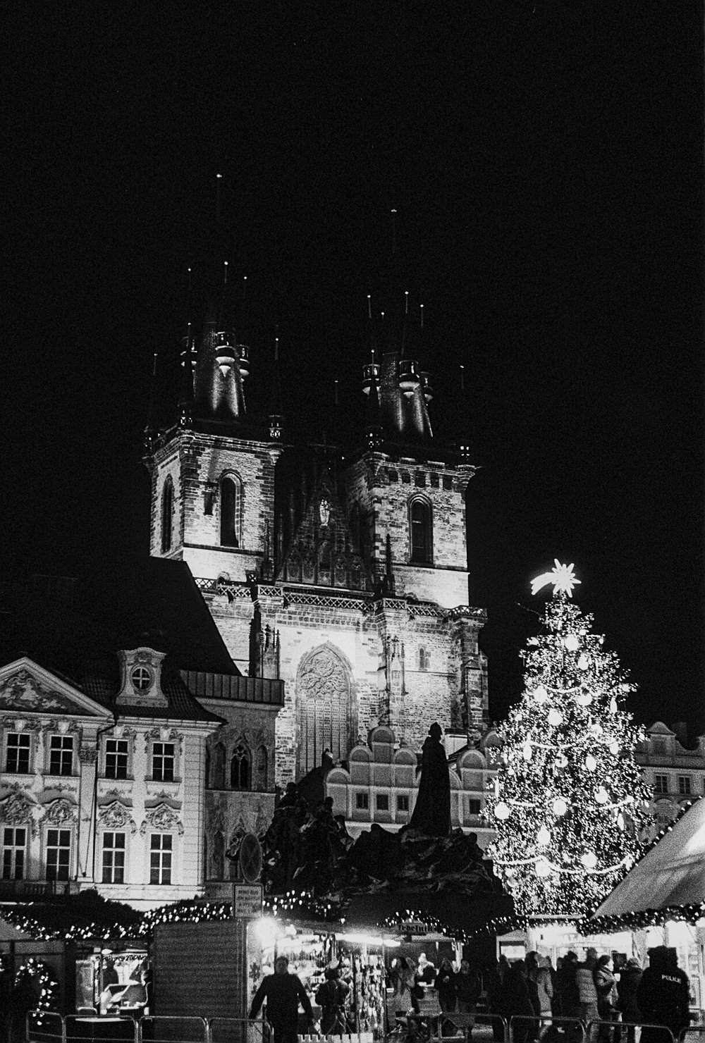 Christmas tree in Old Town Prague at nighttime.