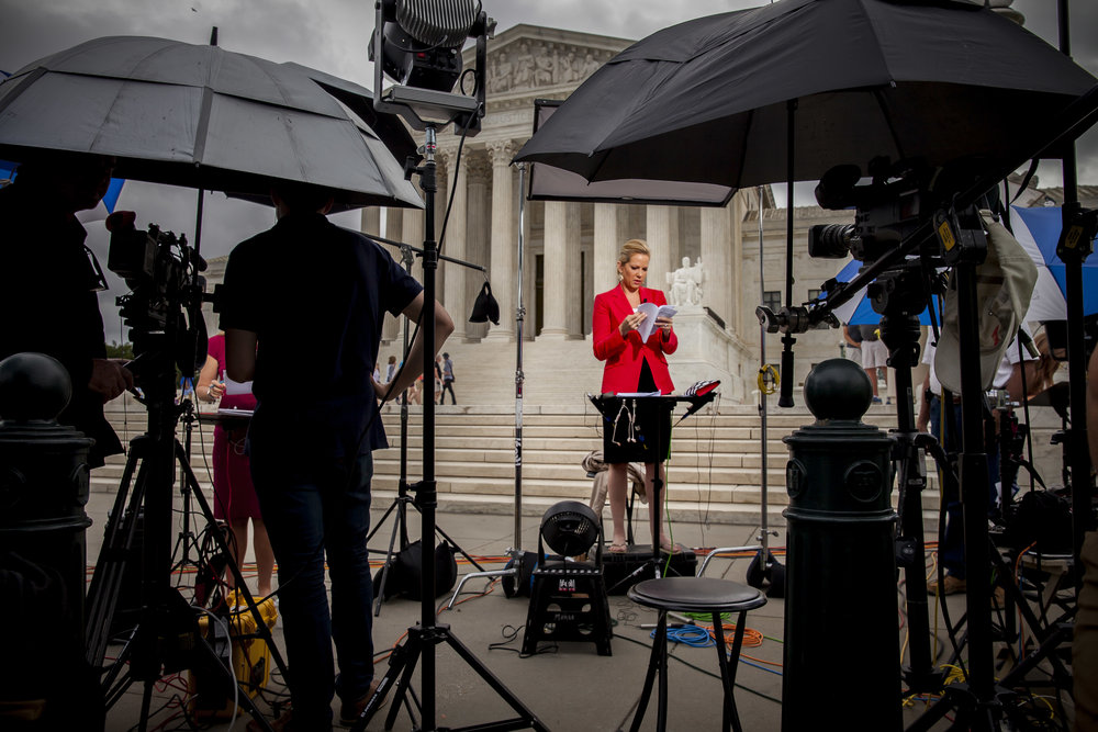 News anchors and TV crews review the ruling for the Janus vs. American Federation of State, Country, and Municipal Employment case that had been announced on June 27th, 2018
