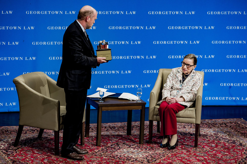 Justice Ruth Bader Ginsburg receives a gift from from Dean William Treanor  after her address to first-year students at Georgetown Law on September 26th, 2018