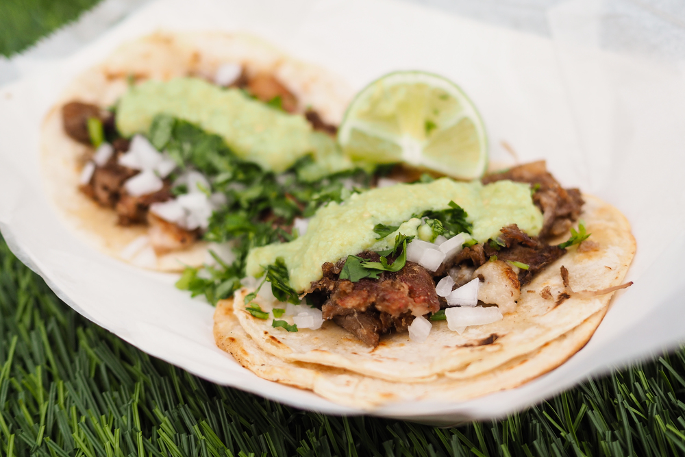 Hunger Street Tacos // TACO de Suadero:  braised brisket with chorizo, onion, cilantro, lime, and house avocado salsa verde served on two freshly made soft corn tortillas.