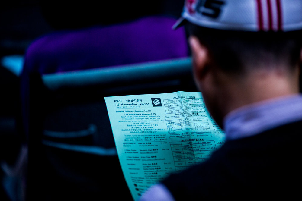 EFCI 1.5 Generation Member Reading the Weekly Bulletin
