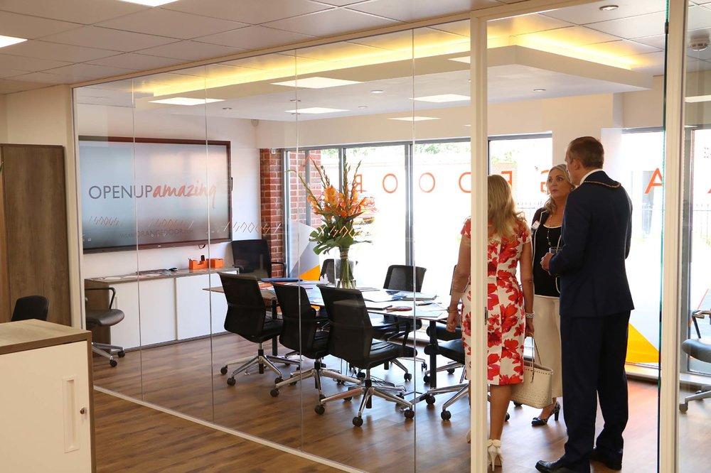 Elizabeth Heron shows the Mayor and the Consort the OrangeDoor board roo....jpg