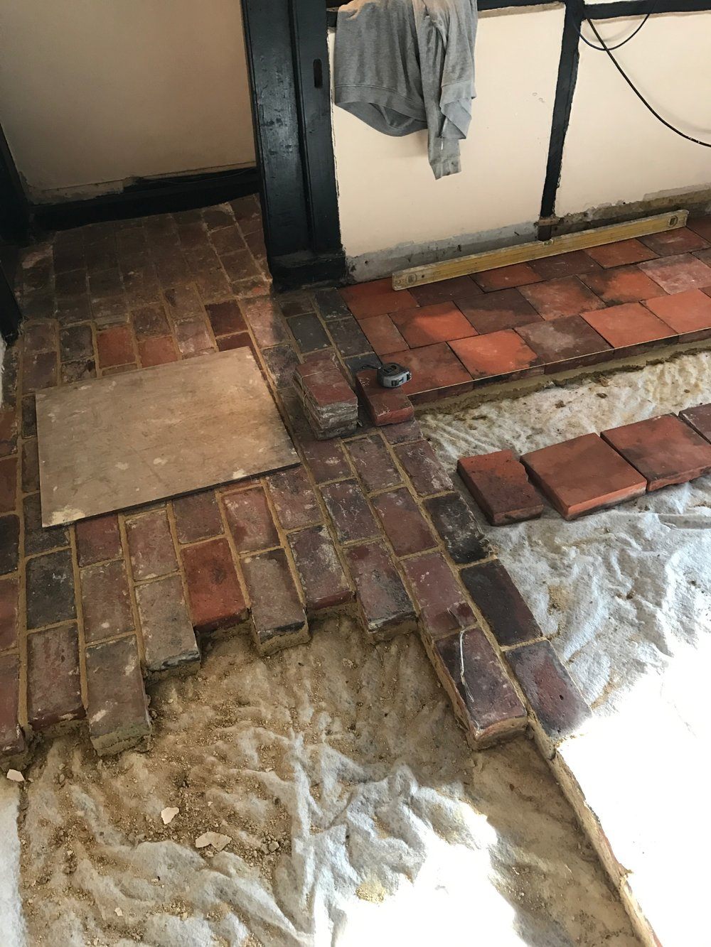 starting to lay bricks.JPG