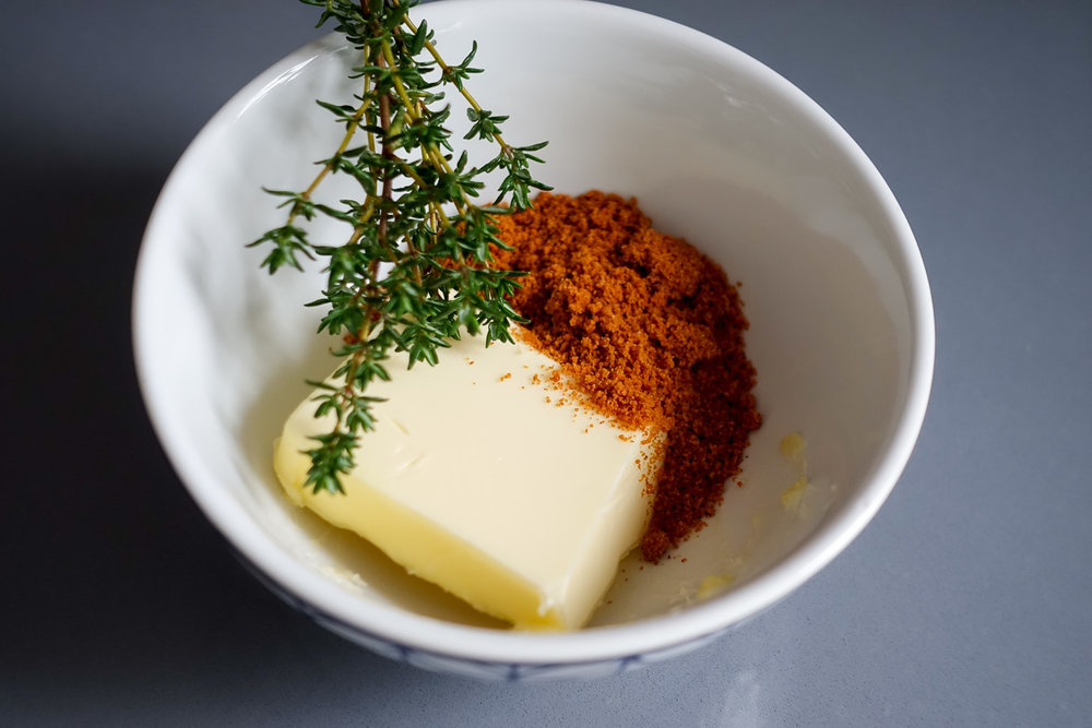 Mix suya spices, butter, thyme and salt into a paste