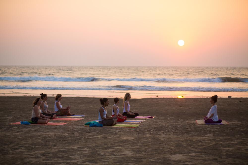 Sunset yoga on Ashwem beach
