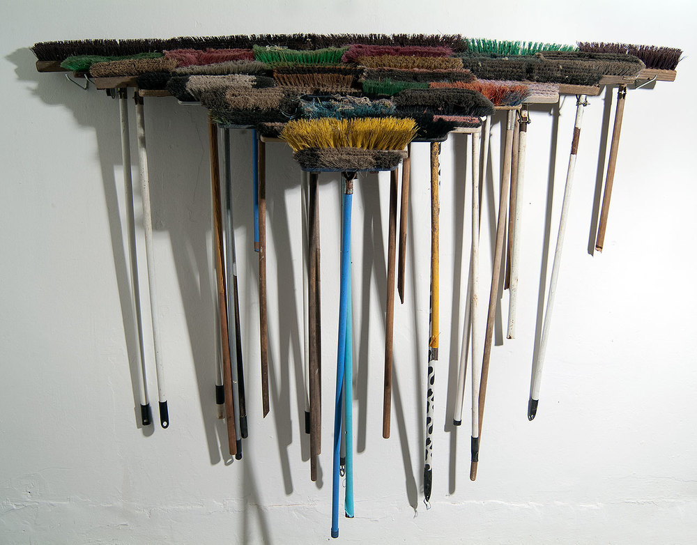 Usha Seejarim,  Triangle  (2012), Sculpture with brooms, 2100 x 480 x 600 mm