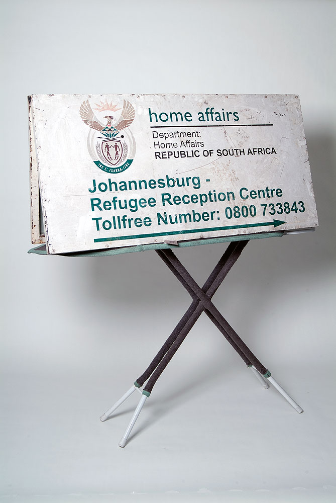 Usha Seejarim , Affairs of the Home  (2012), Sculpture with ironing board and signage boards, 1210 x 400 x 1500 mm