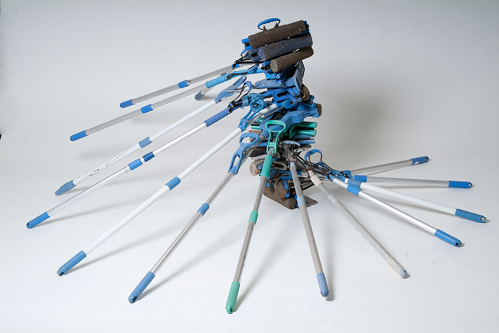 Usha Seejarim , Squeeze  (2012), Sculpture with mops, 1900 x 1950 x 800 mm