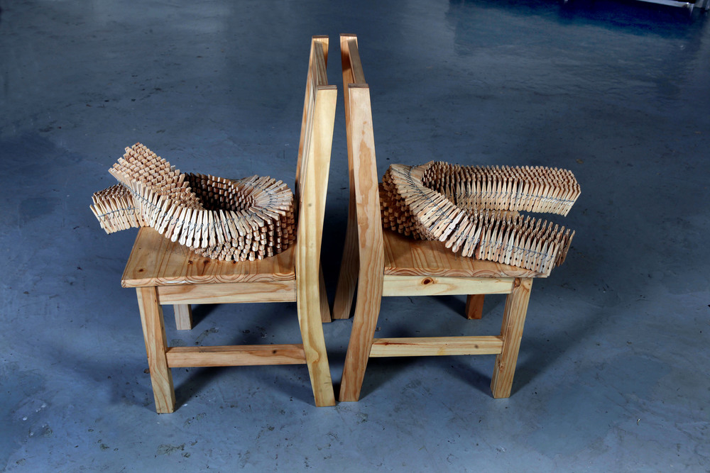 Domestic disagreement (2015), Wooden chairs and pegs, steel wire. 1310 x 910 x 460 mm.