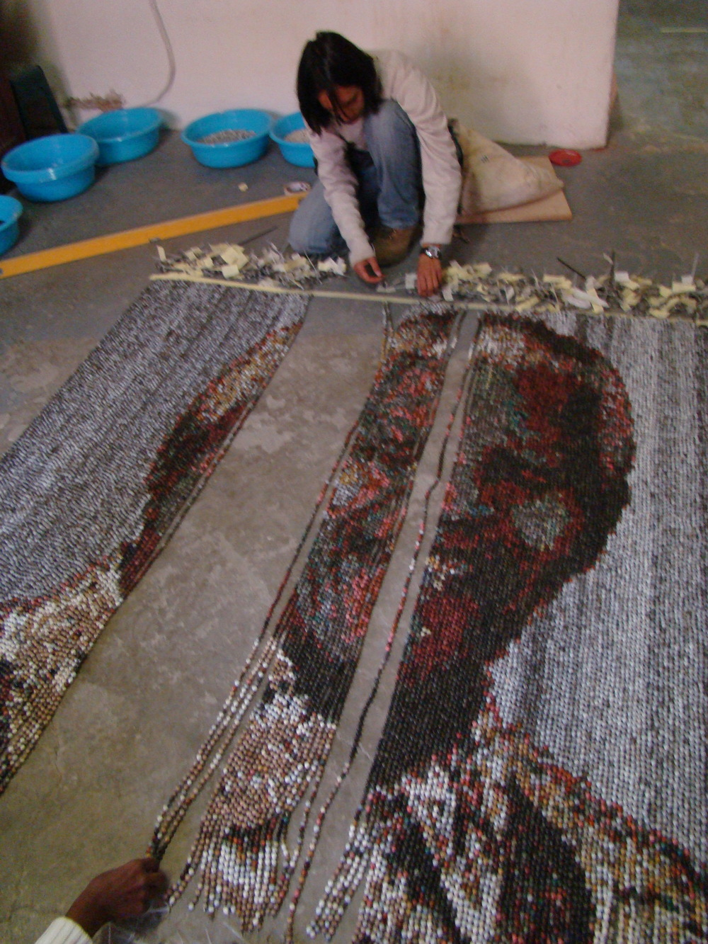 Above:  Beaded portrait of Madiba in progress.  Right:    Nelson Mandela beaded portrait    (2013), Stringed beads, 2000 x 2000 mm.