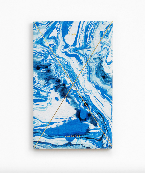 Kostreva, J. (2015).  GOLD FOIL ANY-YEAR DAILY PLANNER - MARBLE INDIGO . [image] Available at: http://www.juliakostreva.com/collections/notebooks/products/gold-foil-any-year-daily-planner-calendar-marble-indigo [Accessed 20 Mar. 2016].