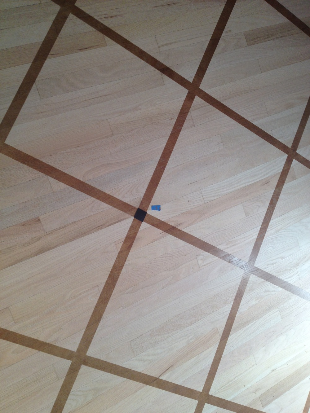 Grid pattern painted kitchen floor
