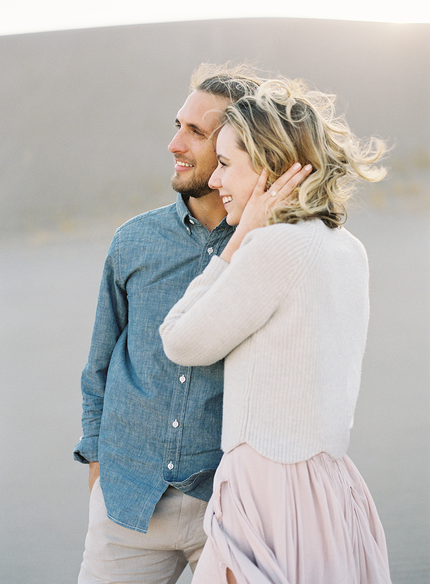 windy sand dunes engagement session
