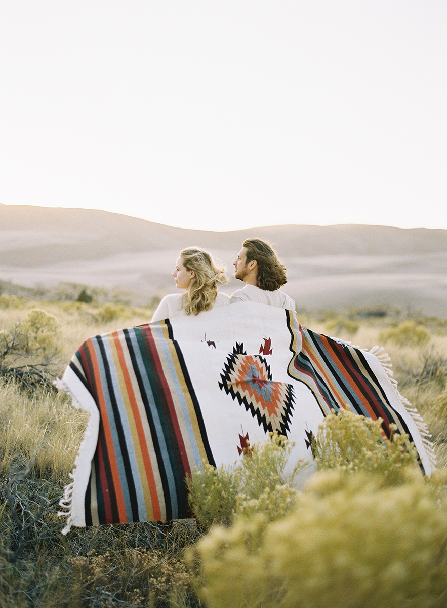 romantic couple with blanket in colorado on film