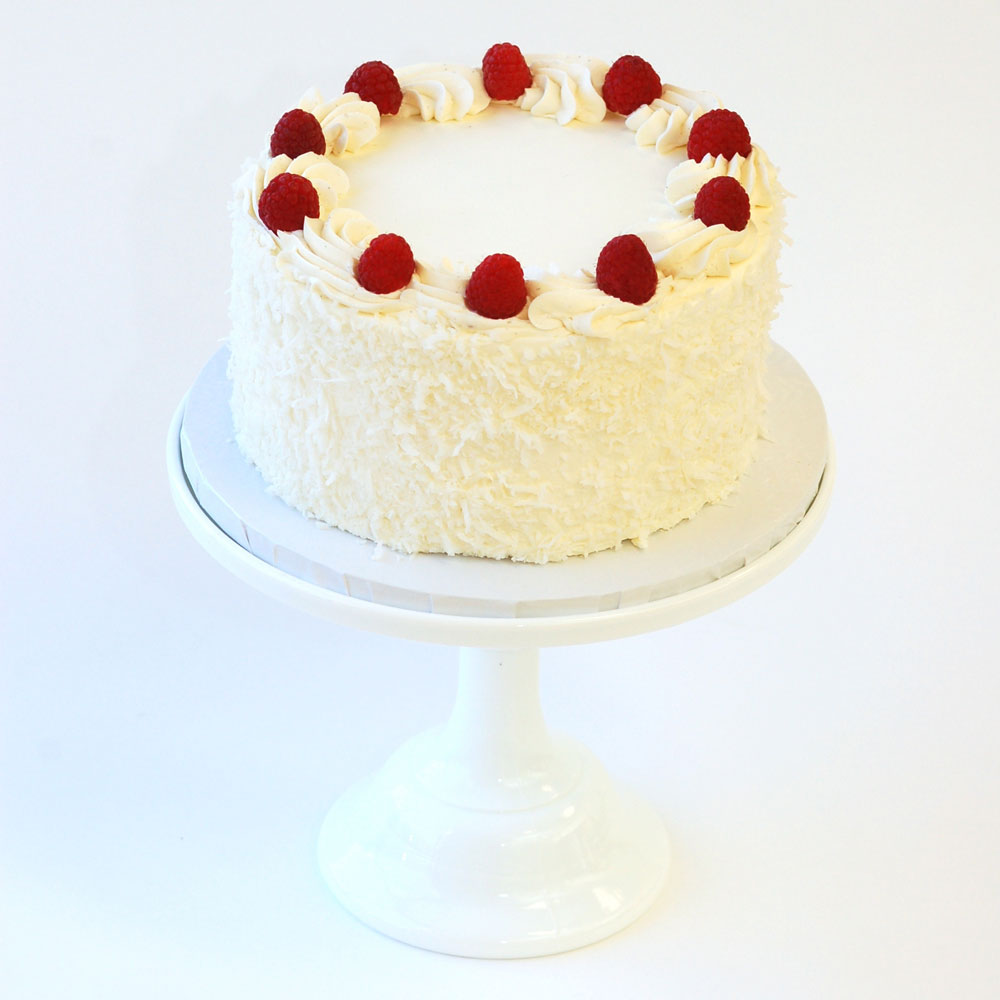 "Coconut Raspberry Cake (Signature)   Cake : Coconut  Filling : Raspberry Jam  Frosting : Coconut Swiss Meringue Buttercream 6"" Round $40 8"" Round $60 10"" Round $90  Can be made vegan."