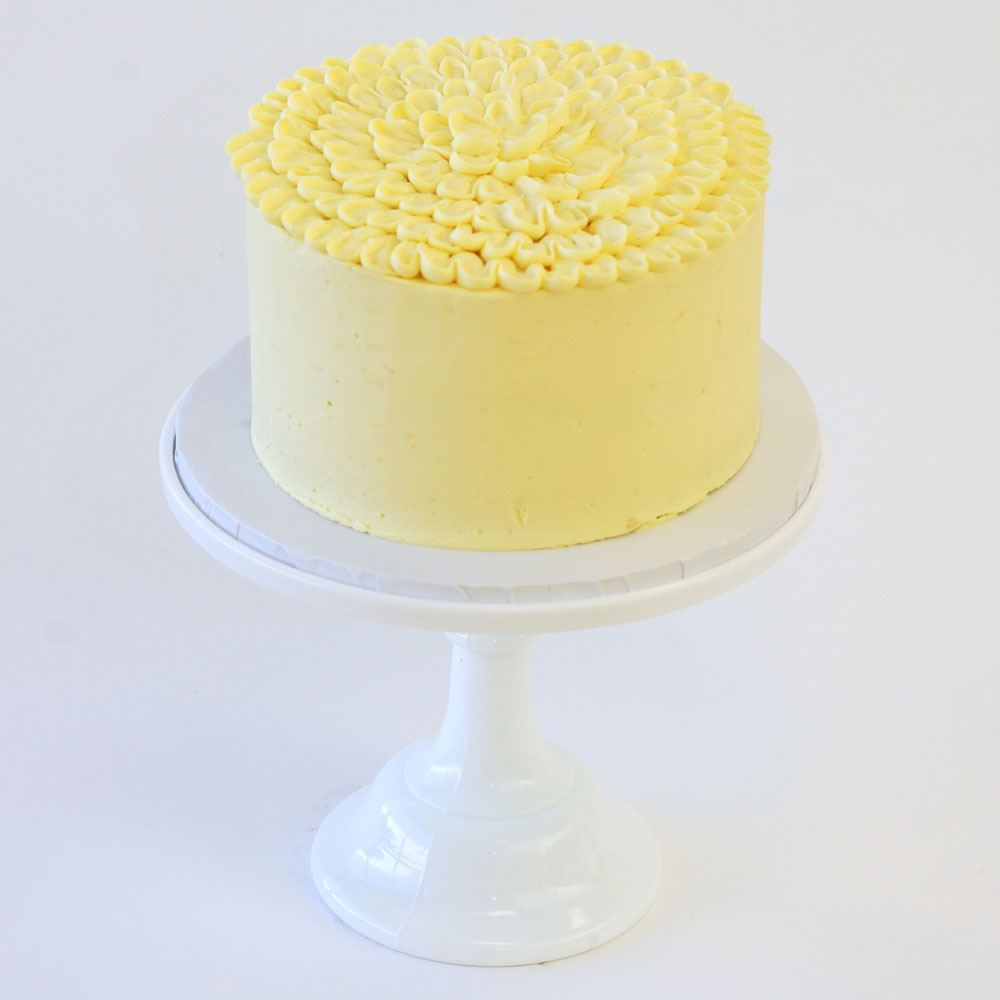 "For the Love of Lemons Cake (Specialty)   Cake : Lemon  Filling : Lemon Curd  Frosting : Lemon Frosting 6"" Round $40 8"" Round $60 10"" Round $90  Can be made Dairy Free."