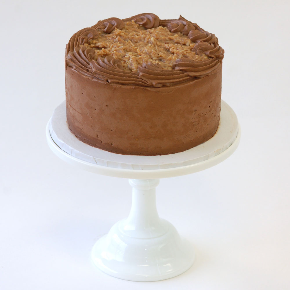 "German Chocolate Cake (Specialty)   Cake : Chocolate  Filling : Coconut-Pecan  Frosting : Chocolate Swiss Meringue Buttercream 6"" Round $50 8"" Round $75 10"" Round $110"
