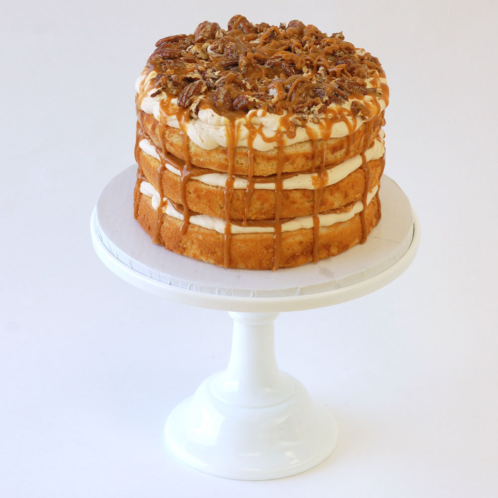 "Praline Pecan Cake (Specialty) Cake: Vanilla Filling: Salted Caramel Frosting: Vanilla Swiss Meringue Buttercream 6"" Round $50 8"" Round $75 10"" Round $110 Topped with candied pecans."