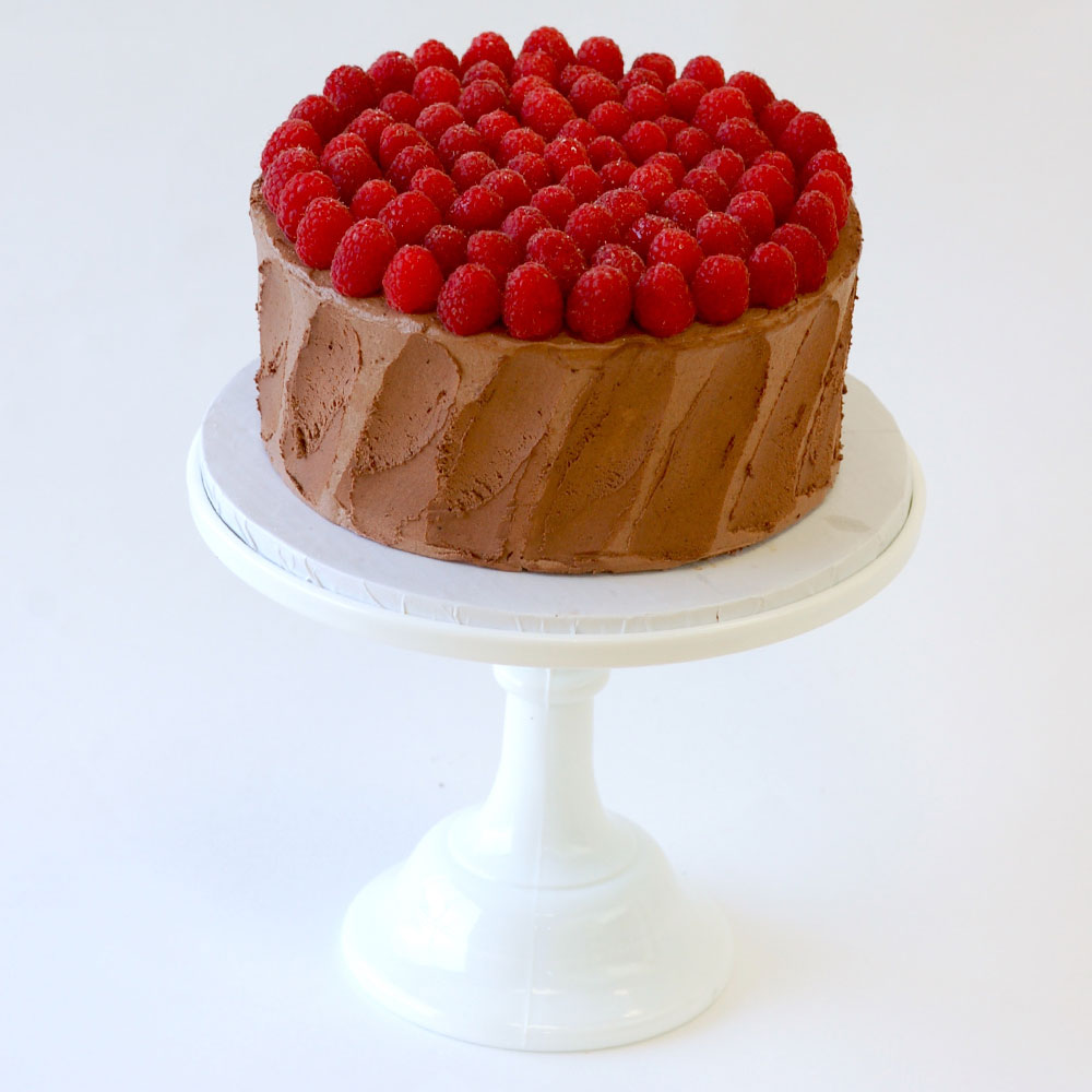 "The Divine Chocolate Raspberry Cake (Specialty)   Cake : Chocolate  Filling : Raspberry Jam  Frosting : Chocolate Swiss Meringue Buttercream 6"" Round $50 8"" Round $75 10"" Round $110  Can be made vegan."