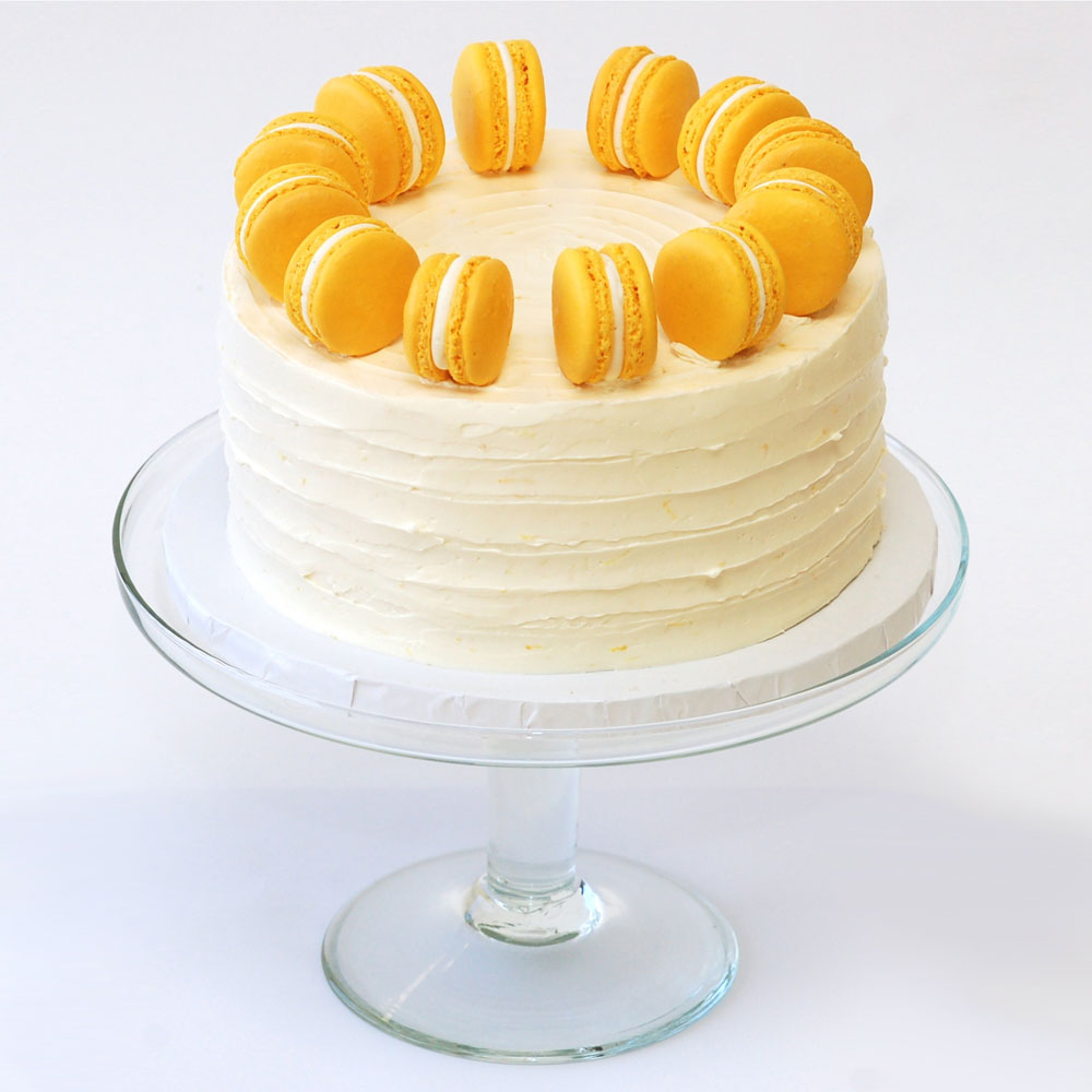 "The Honey Bee Cake   Cake : Vanilla  Filling : Honey Mousse  Frosting : Vanilla-Bean Swiss Meringue Buttercream 6"" Round $60.99 8"" Round $89.99  6"" has 8 French Macaroons, 8"" has 12 French Macaroons."