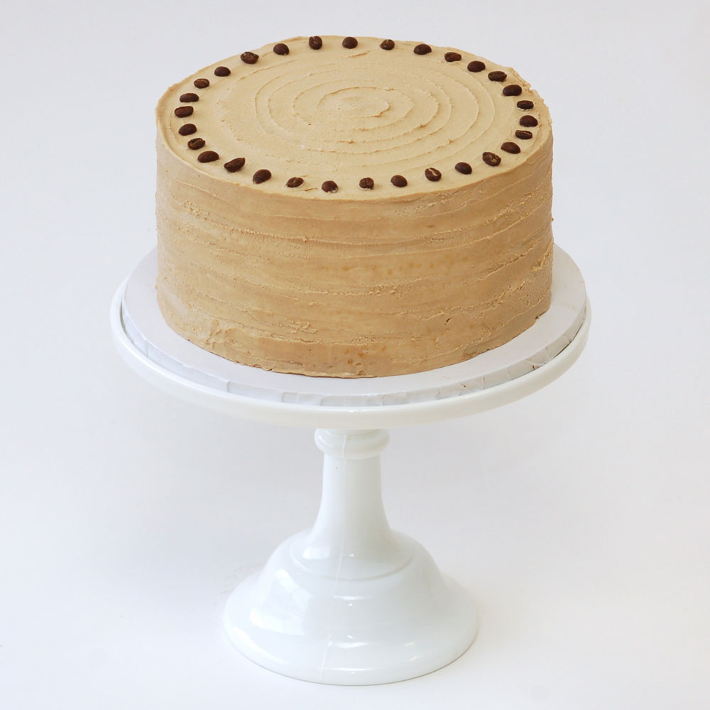 "The Mocha Cake (Signature)   Cake : Chocolate  Filling : Espresso Ganache  Frosting : Stumptown® Coffee Swiss Meringue Buttercream 6"" Round $40 8"" Round $60 10"" Round $90  Topped with espresso beans."