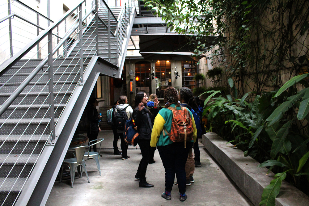 Fellows arrive at Red Bull Station, an old electrical station downtown