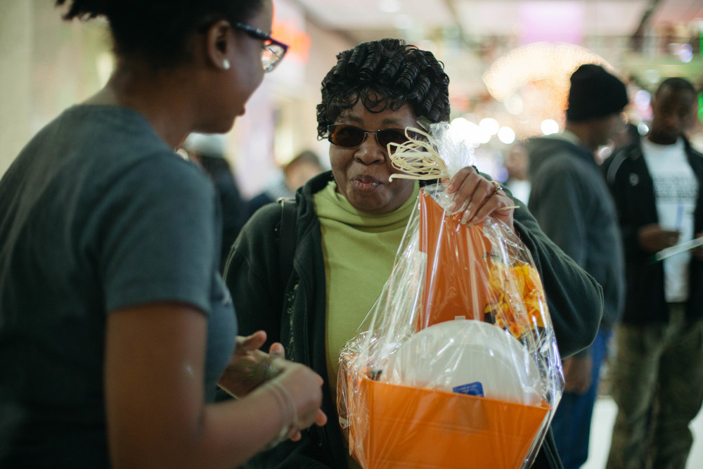 Woman receives basket at Turkey Bash