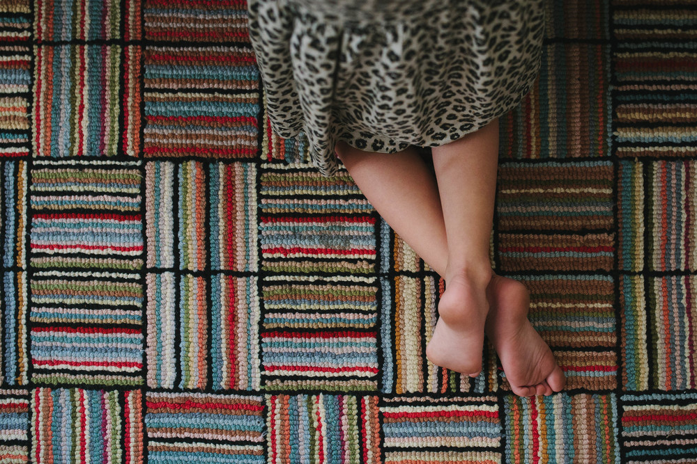 Image from family documentary session of girl's crossed legs