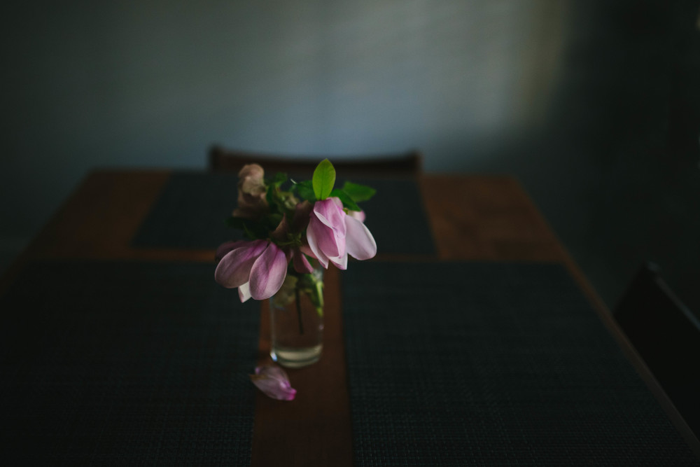 Image from family documentary session of flowers on dining room table