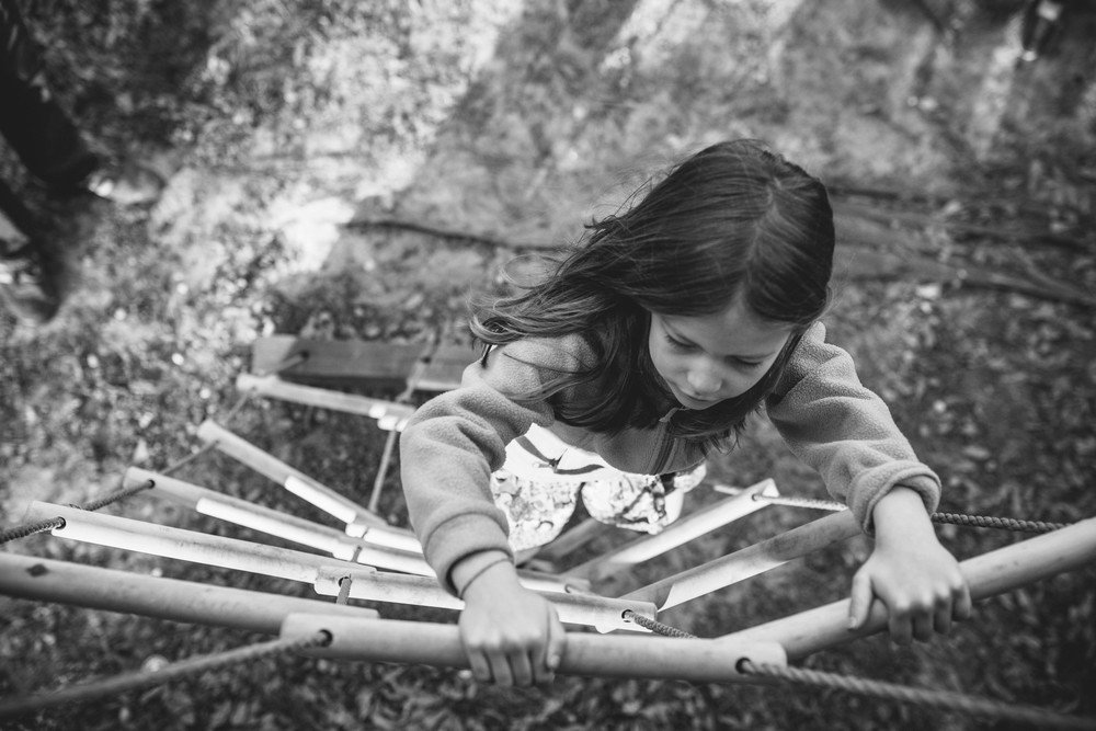 Image from family documentary session of girl climbing rope ladder