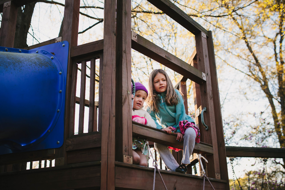 Image from family documentary session of sisters on play structure