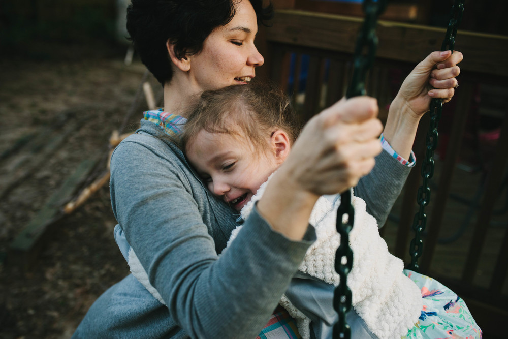 Image from family documentary session of daughter swinging on mother