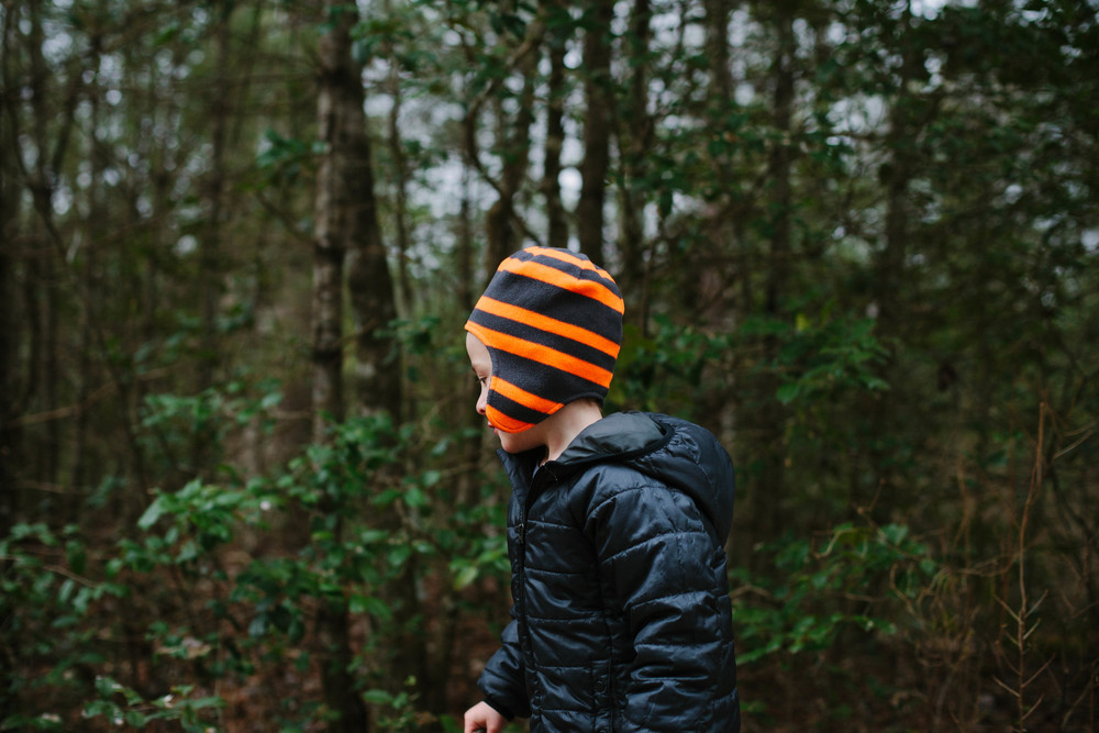 Image of boy in stocking hat in forest