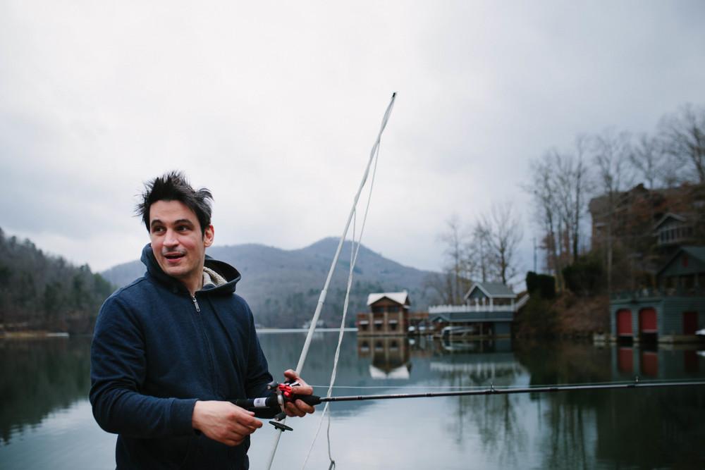 Image of man holding fishing pole