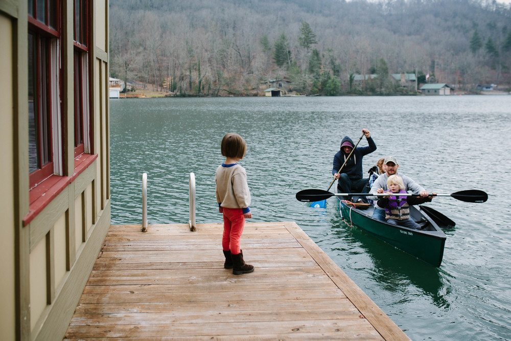 Image of girl standing on dock waiting for canoe